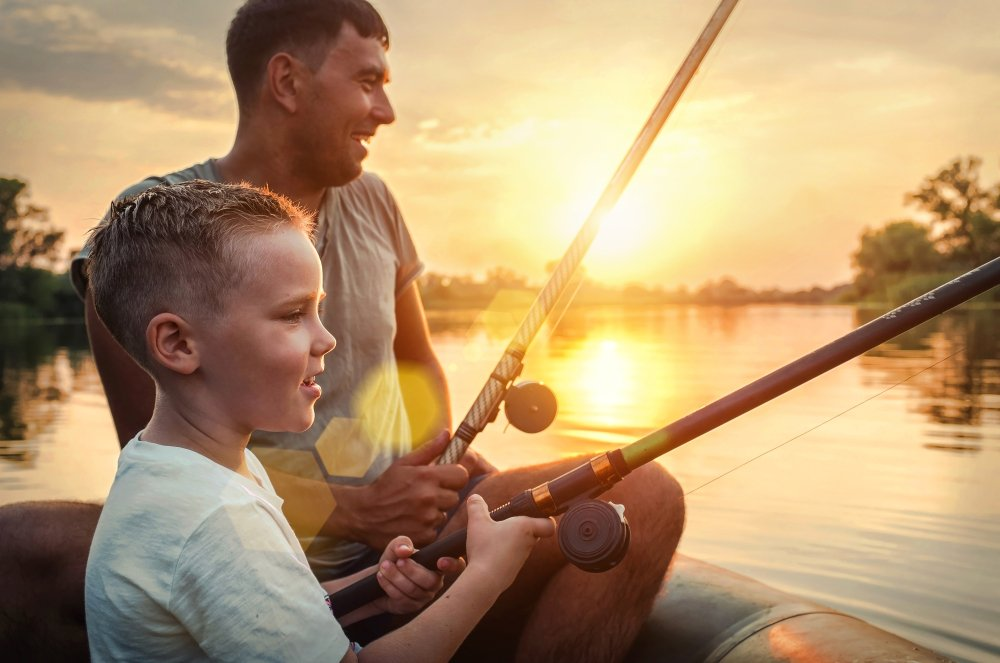 Father and son fishing on Family Vacations in Canada