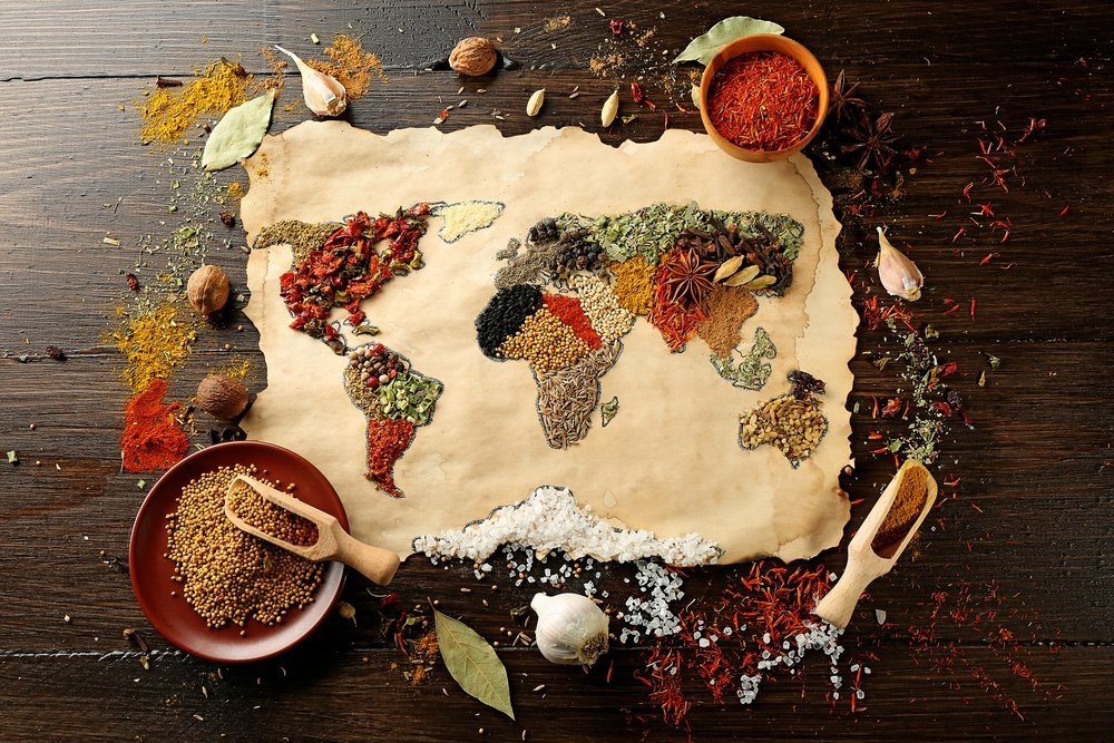 Spices arranged to create the shape of a Food travel map